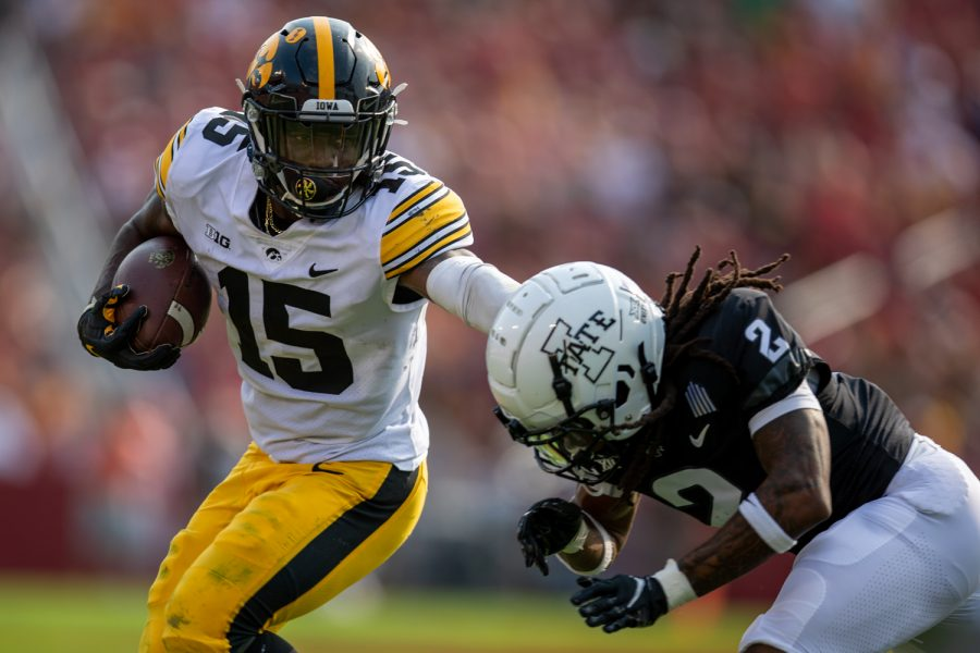 Iowa running back Tyler Goodson stiff-arms defensive back Datrone Young during a football game between No. 10 Iowa and No. 9 Iowa State at Jack Trice Stadium in Ames on Saturday, Sept. 11, 2021. The Hawkeyes defeated the Cyclones 27-17.