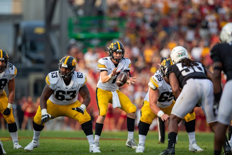 Iowa quarterback Spencer Petras catches the snap during a football game between No. 10 Iowa and No. 9 Iowa State at Jack Trice Stadium in Ames on Saturday, Sept. 11, 2021. The Hawkeyes defeated the Cyclones 27-17.