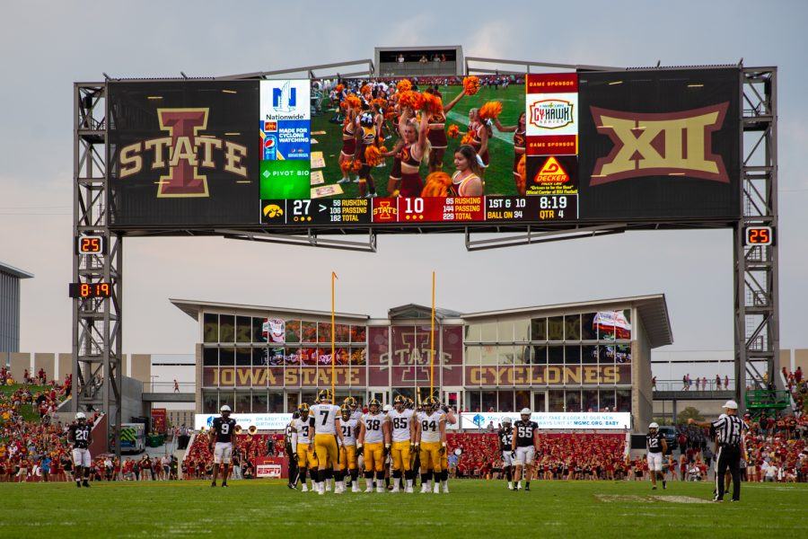 Iowa huddles up before a play during a football game between No. 10 Iowa and No. 9 Iowa State at Jack Trice Stadium in Ames on Saturday, Sept. 11, 2021. The Hawkeyes defeated the Cyclones 27-17.