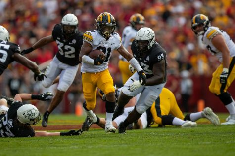 Iowa running back Ivory Kelly-Martin breaks free during a football game between No. 10 Iowa and No. 9 Iowa State at Jack Trice Stadium in Ames on Saturday, Sept. 11, 2021. The Hawkeyes defeated the Cyclones 27-17.