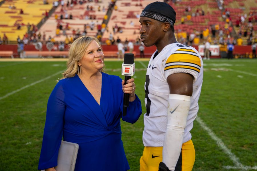 ESPN reporter Holly Rowe interviews Iowa defensive back Matt Hankins after a football game between No. 10 Iowa and No. 9 Iowa State at Jack Trice Stadium in Ames on Saturday, Sept. 11, 2021. The Hawkeyes defeated the Cyclones 27-17.