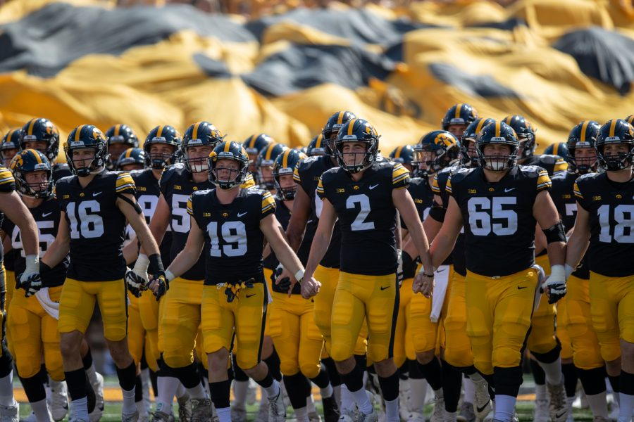 The Hawkeyes take the field during a football game between Iowa and Kent State at Kinnick Stadium on Saturday, Sept. 18, 2021.