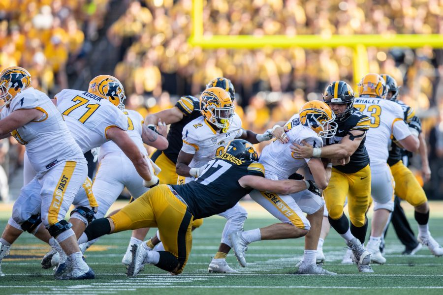 Iowa defensive linemen Joe Evans and Zach VanValkenburg combine for a sack during a football game between Iowa and Kent State at Kinnick Stadium on Saturday, Sept. 18, 2021. The Hawkeyes defeated the Golden Flashes 30-7. The Iowa defense forced seven sacks.