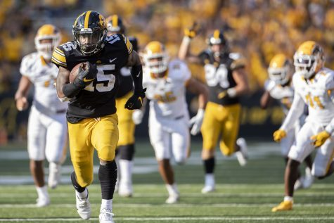 Iowa running back Tyler Goodson runs the ball toward the end zone for a touchdown during a football game between Iowa and Kent State at Kinnick Stadium on Saturday, Sept. 18, 2021. The Hawkeyes defeated the Golden Flashes with a score of 30-7.