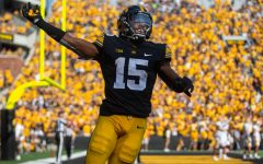 Iowa running back Tyler Goodson pumps up the crowd after a touchdown during a football game between Iowa and Kent State at Kinnick Stadium on Saturday, Sept. 18, 2021. The Hawkeyes defeated the Golden Flashes with a score of 30-7.