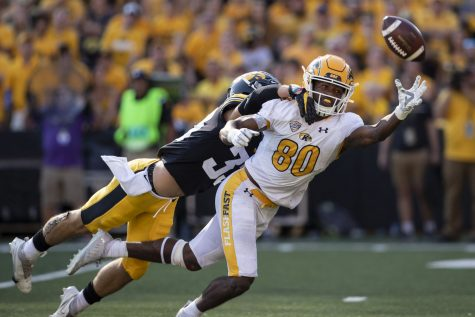 Kent State wide receiver Keshunn Abram attempts to catch a ball during a football game between Iowa and Kent State at Kinnick Stadium on Saturday, Sept. 18, 2021. The Hawkeyes defeated the Golden Flashes with a score of 30-7. Abram had 138 yards and one touchdown.