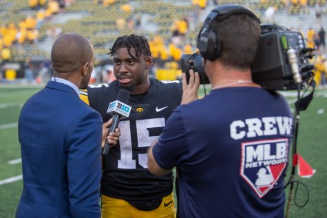 Iowa running back Tyler Goodson answers questions from Big Ten Network sideline reporter Cole Harvey after a football game between Iowa and Kent State at Kinnick Stadium on Saturday, Sept. 18, 2021. The Hawkeyes defeated the Golden Flashes 30-7.