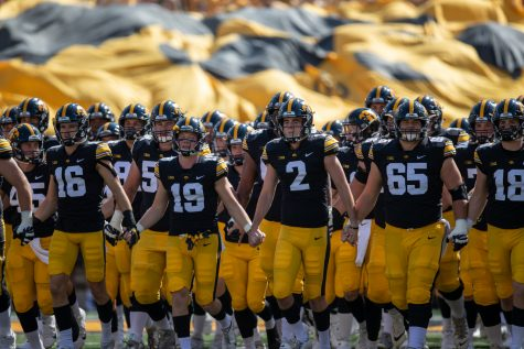 The Hawkeyes take the field during a football game between Iowa and Kent State at Kinnick Stadium on Saturday, Sept. 18, 2021. (Jerod Ringwald/The Daily Iowan)