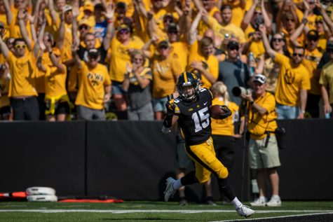 Iowa running back Tyler Goodson puts up the peace sign while running into the end zone for a touchdown during a football game between Iowa and Kent State at Kinnick Stadium on Saturday, Sept. 18, 2021. (Jerod Ringwald/The Daily Iowan)