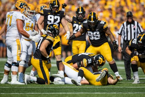 Iowa linebacker Jack Campbell tackles Kent State running back Marquez Cooper during a football game between Iowa and Kent State at Kinnick Stadium on Saturday, Sept. 18, 2021. The Hawkeyes defeated the Golden Flashes 30-7. (Jerod Ringwald/The Daily Iowan)