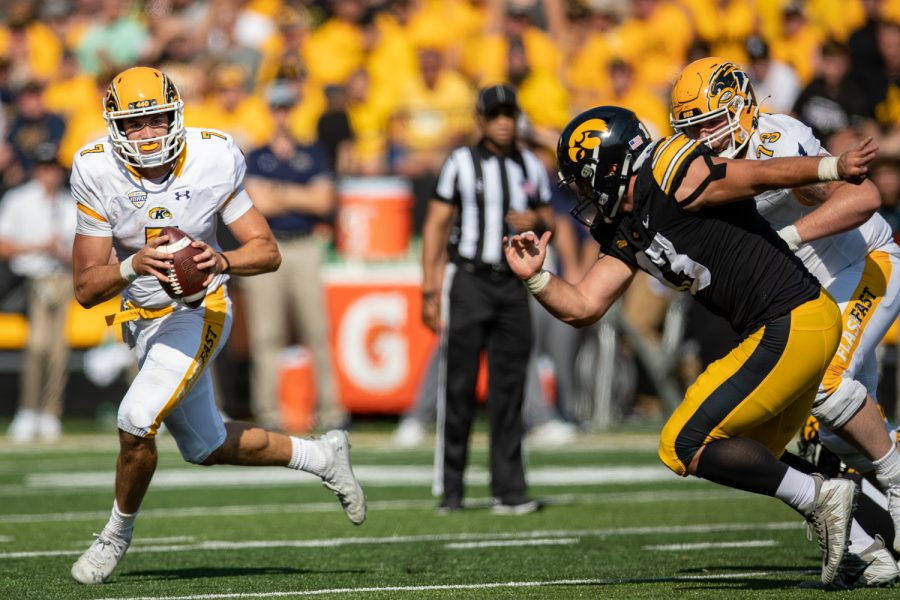 Kent State quarterback Dustin Crum scrambles away from Iowa defensive end Joe Evans during a football game between Iowa and Kent State at Kinnick Stadium on Saturday, Sept. 18, 2021. The Hawkeyes defeated the Golden Flashes 30-7. (Jerod Ringwald/The Daily Iowan)