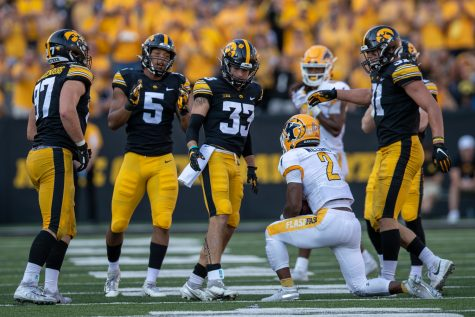 Iowa defensive back Riley Moss looks down at Kent State running back Xavier Williams during a football game between Iowa and Kent State at Kinnick Stadium on Saturday, Sept. 18, 2021. The Hawkeyes defeated the Golden Flashes 30-7. (Jerod Ringwald/The Daily Iowan)