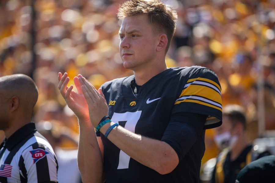 Iowa+quarterback+Spencer+Petras+claps+after+the+national+anthem+during+a+football+game+between+Iowa+and+Kent+State+at+Kinnick+Stadium+on+Saturday%2C+Sept.+18%2C+2021.+The+Hawkeyes+defeated+the+Golden+Flashes+30-7.+%28Jerod+Ringwald%2FThe+Daily+Iowan%29