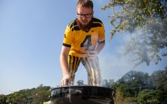 Josh Shaw grills in Iowa City before a football game between No. 5 Iowa and Kent State on Saturday, Sept. 18, 2021.