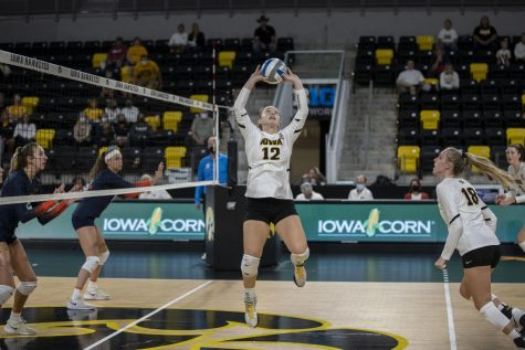 Iowa setter Bailey Ortega sets the ball during a volleyball game between Iowa and Illinois at Xtreme Arena in Coralville, Iowa, on Wednesday, Sept. 22, 2021. The Fighting Illini defeated the Hawkeyes with a score of 3-2.