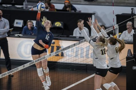 Illinois outside hitter Raina Terry spikes the ball during a volleyball game between Iowa and Illinois at Xtreme Arena in Coralville, Iowa, on Wednesday, Sept. 22, 2021. The Fighting Illini defeated the Hawkeyes with a score of 3-2.