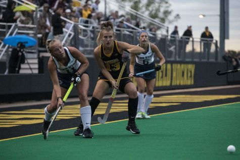 Iowa forward Leah Zellner looks to defender Penn State forward Meghan Reese as she passes to her teammate at Grant field on Friday Sept. 24, 2021. The Hawkeyes defeated the Lions 1-0.