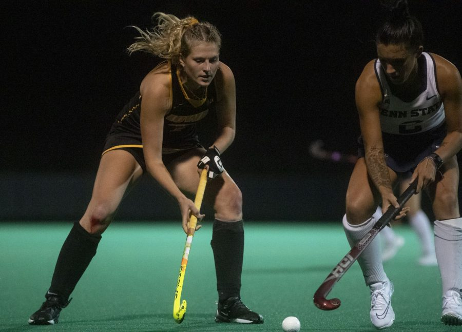 Iowa midfielder Ellie Holley works to move around a Penn State defender at Grant field on Friday Sept. 24, 2021. The Hawkeyes defeated the Nittany Lions 1-0.