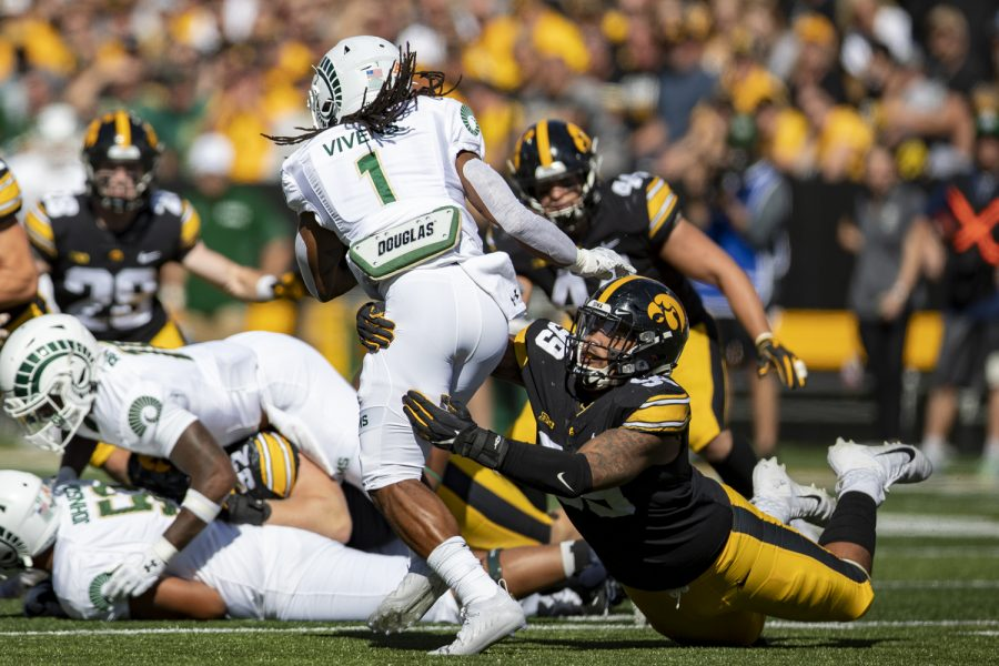 Iowa defensive lineman Noah Shannon makes a tackle on Colorado State running back AJon Vivens during a football game between Iowa and Colorado State at Kinnick Stadium on Saturday, Sept. 25, 2021. (Jerod Ringwald/The Daily Iowan)