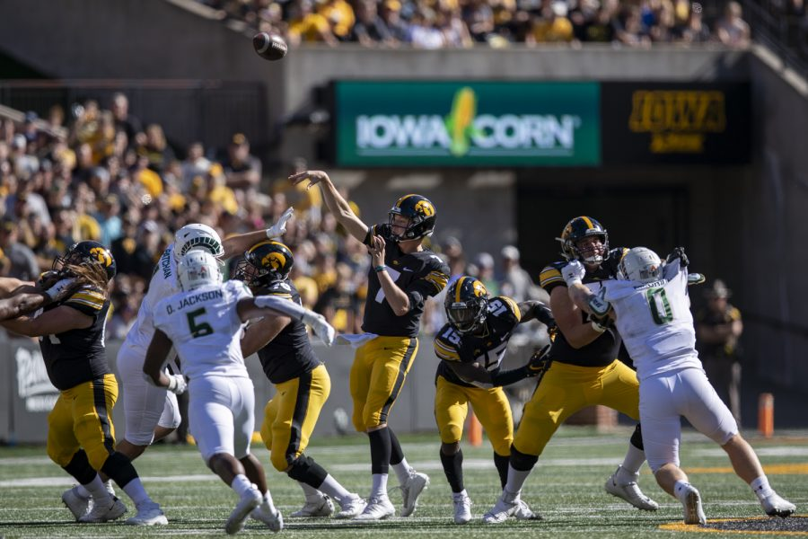 Iowa quarterback Spencer Petras throws the football during a football game between Iowa and Colorado State at Kinnick Stadium on Saturday, Sept. 25, 2021. (Jerod Ringwald/The Daily Iowan)