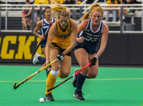 Iowa and Penn State fight for position during a field hockey game between Iowa and Penn State on Sunday, Sept. 26, 2021, at Grant Field. The Hawkeyes defeated the Nittany Lions 4-0.