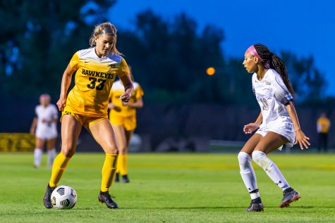 Iowa defender Riley Burns dribbles the ball during the Iowa Soccer game against Purdue-Fort Wayne on Sep. 2, 2021 at the Iowa Soccer Complex. Iowa defeated Purdue-Fort Wayne, 5-0.