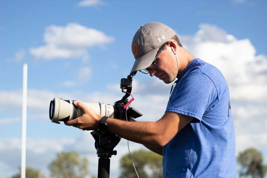 University of Iowa junior Kayd Nissen records footage at a Clear Creek Amana high school football practice on Wednesday, Sept. 8, 2021.