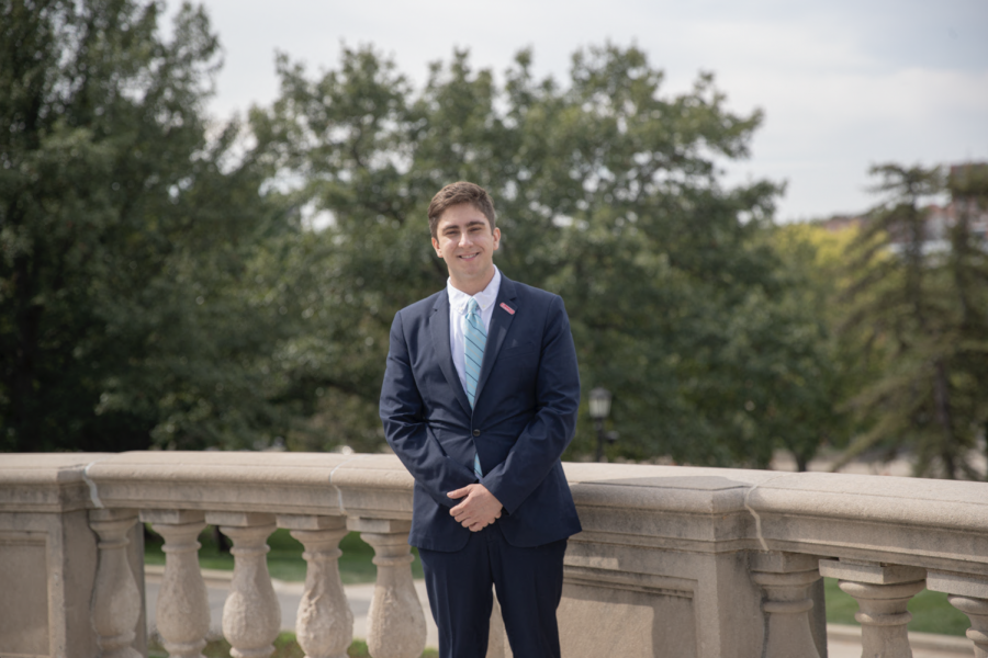 Andrew Dunn, an undergraduate political science student, stands at the Old Capitol.