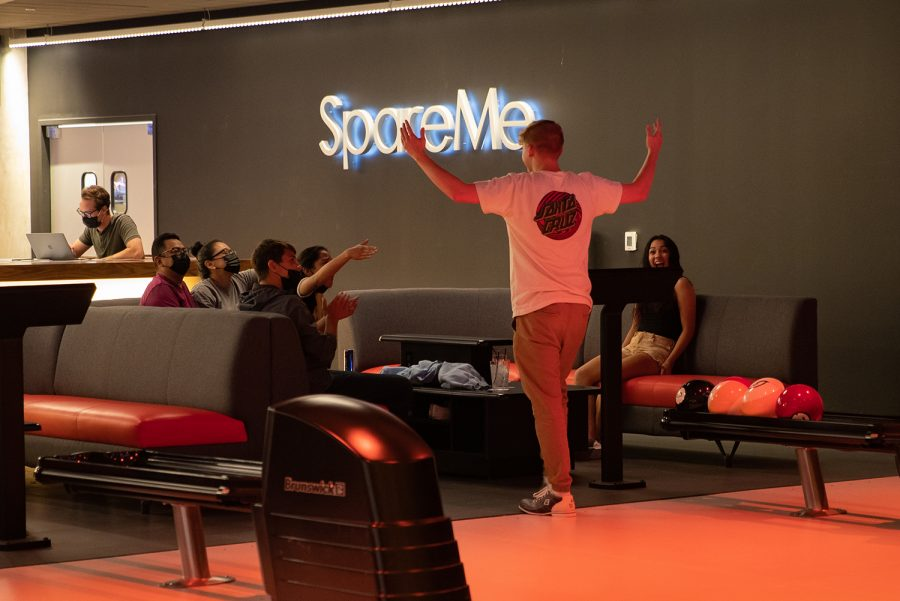 Bowlers celebrate in the bowling alley SpareMe on Wednesday, Sept. 15, 2021. (Larry Phan/The Daily Iowan)