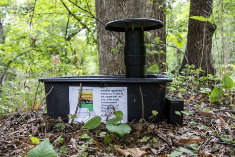 A mosquito trap is seen on Tuesday, Aug. 31, 2021. The trap, placed by Johnson County Public Health Mosquito Surveillance Program, is located just off a trail in Hickory Hill park. The park is located at 1439 E Bloomington St.