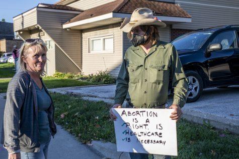 Gene Haighr speaks with Johnsons County Supervisor Jon Green outside the Emma Goldman Clinic on Thursday, Sept.9,.2021. Haighr questions Supervisor Green on his choices.