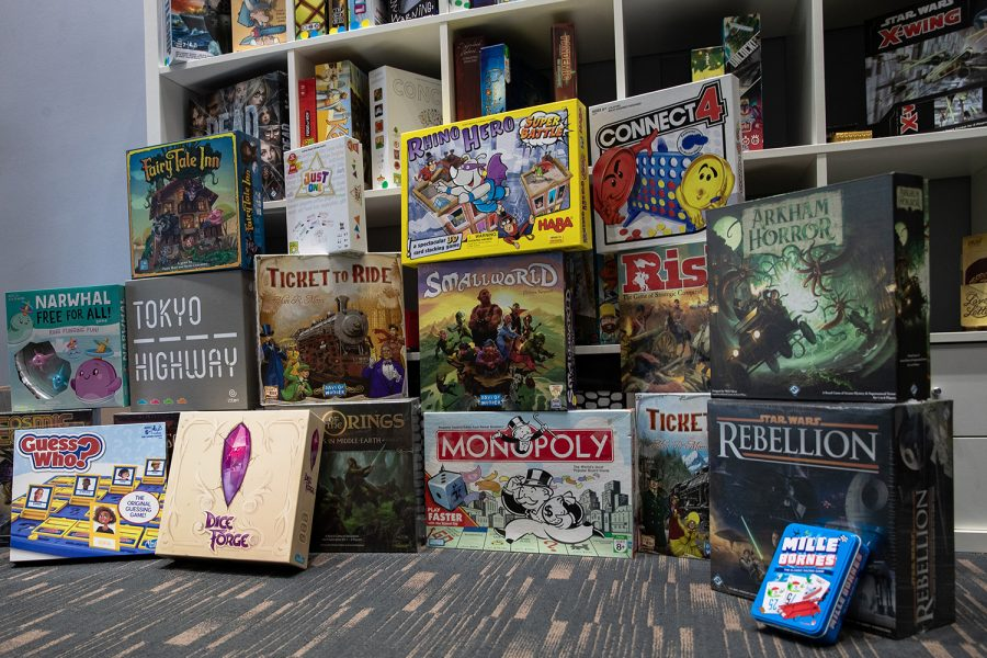 A+shelf+of+board+games+is+shown+from+the+inside+of+the+board+cafe%2C+Fortuna+in+Iowa+City+on+Sept.+29%2C+2021.+These+are+a+few+of+many+games+that+Fortuna+is+planning+on+having+in+their+inventory%2C+hoping+to+games+suited+for+everyone+to+enjoy+playing.+Store+manager%2C+Ryan+Graham+said+that+the+cafe+%E2%80%9Cis+supposed+to+be+a+happy+place%2C+somewhere+to+not+be+taking+yourself+so+serious%E2%80%9D.+%28Larry+Phan%2FThe+Daily+Iowan%29