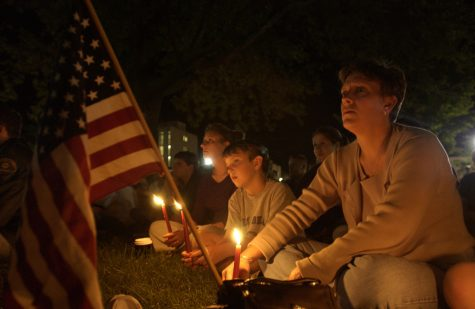 Iowa City resident Kitty Lake and her children listen at the candle light vigil on Sept. 11, 2001 on the Pentacrest.