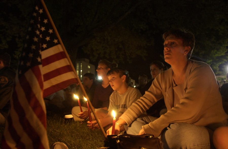 Iowa+City+resident+Kitty+Lake+and+her+children+listen+at+the+candle+light+vigil+on+Sept.+11%2C+2001+on+the+Pentacrest.