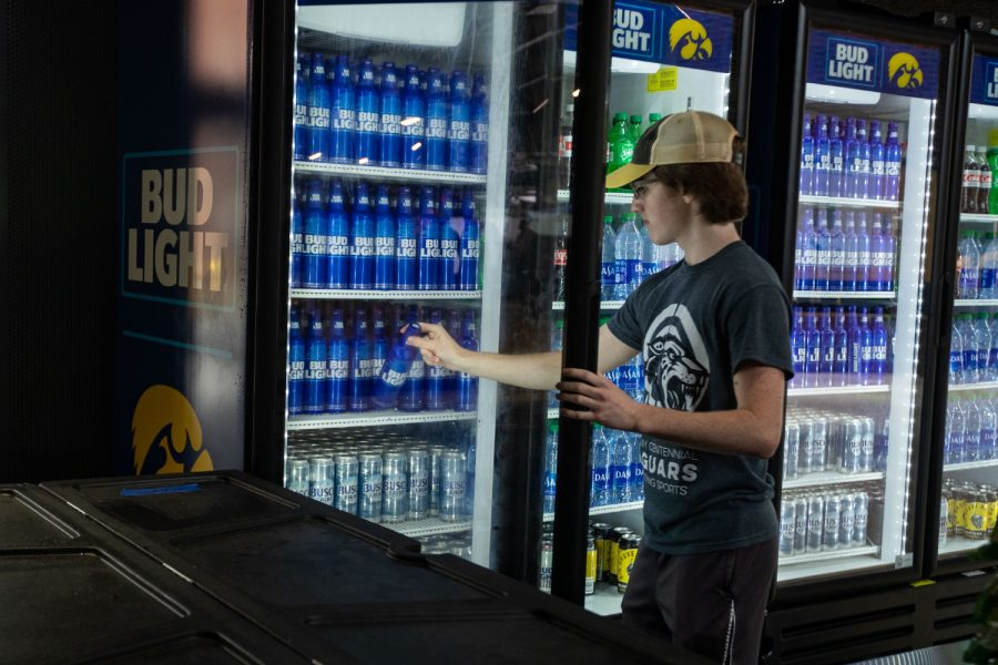 A concession stand attendant serves an alcoholic beverage during a football game between No. 18 Iowa and No. 17 Indiana at Kinnick Stadium on Saturday, Sept. 4, 2021. The Hawkeyes defeated the Hoosiers 34-6. This is the first season Kinnick Stadium has sold alcohol.