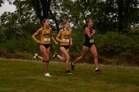 Iowa runners Lauren McMahon (left) and Miriam Sandeen (right) compete in the Hawkeye Invite meet at the Ashton Cross Country Course on Friday, Sept. 3, 2021.