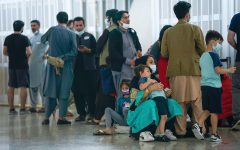 Aug 26, 2021; Dulles, VA, USA; Afghan refugees arrive at Dulles International Airport in Northern Virginia while en route to military facilities in the U.S.Mandatory Credit: Jack Gruber-USA TODAY