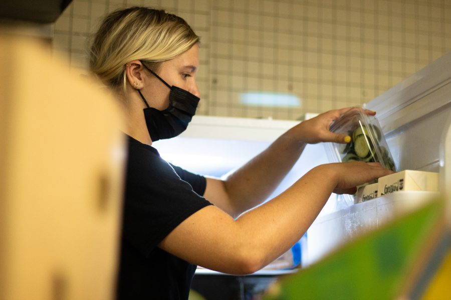 Syd Conaway tucks away some food at the University of Iowa Food Pantry Monday, Sept. 13, 2021.