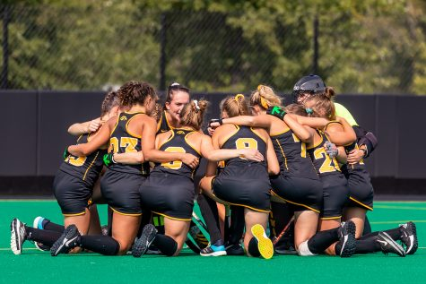 The Iowa Hawkeyes huddle together before the Iowa Field Hockey game against Ohio University on Sep. 10, 2021 at Grant Field. Iowa defeated Ohio 8-0. (Casey Stone/The Daily Iowan)
