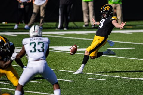 Iowa punter Tory Taylor kicks the ball during a football game between Iowa and Michigan State in Kinnick Stadium on Saturday, Nov. 7, 2020. The Hawkeyes dominated the Spartans, 49-7. (Shivansh Ahuja/The Daily Iowan)
