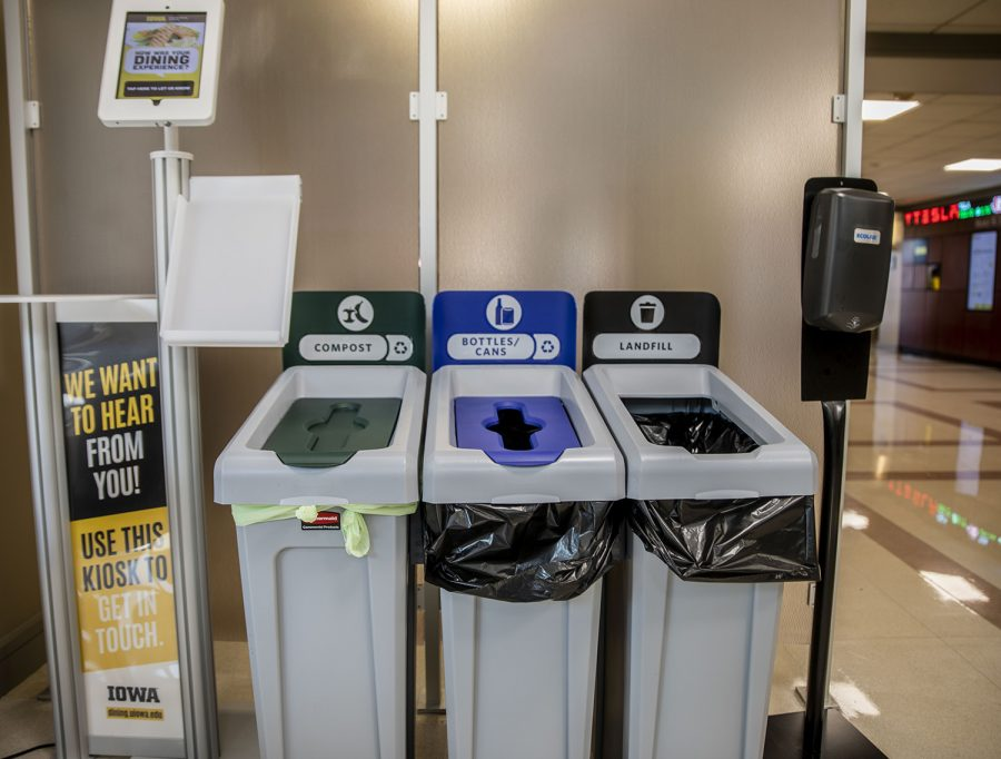 A new green compost bin is seen on Monday, Aug. 30, 2021. The new bin can be found in Pat's Diner which is located in the Tippie College of Business building. (Jeff Sigmund/Daily Iowan)