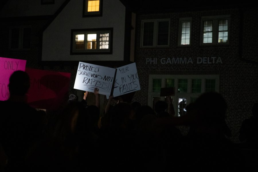 People protest during the third night of protests following sexual assault allegations against the University of Iowa's chapter of Phi Gamma Delta at the chapter structure on Thursday, Sept. 2, 2021. (Grace Smith/The Daily Iowan)