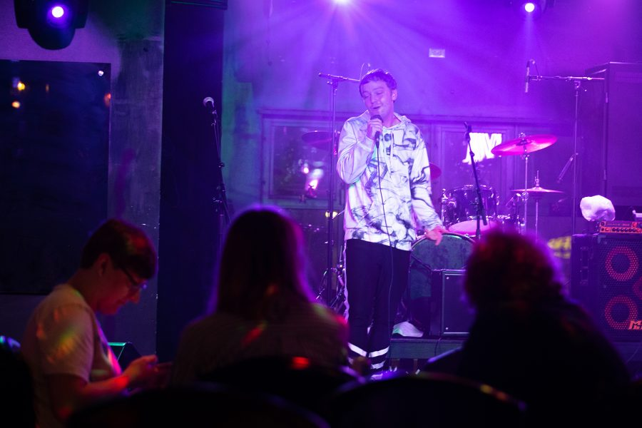 """Solo musician Cam Dukes is shown performing at El Ray's Live & Dive on Sept. 20, 2021. He has came a long way from his first performance, now moving around the stage more and being more expressive. """"My first time, I was standing in one spot, covering over the mic."""