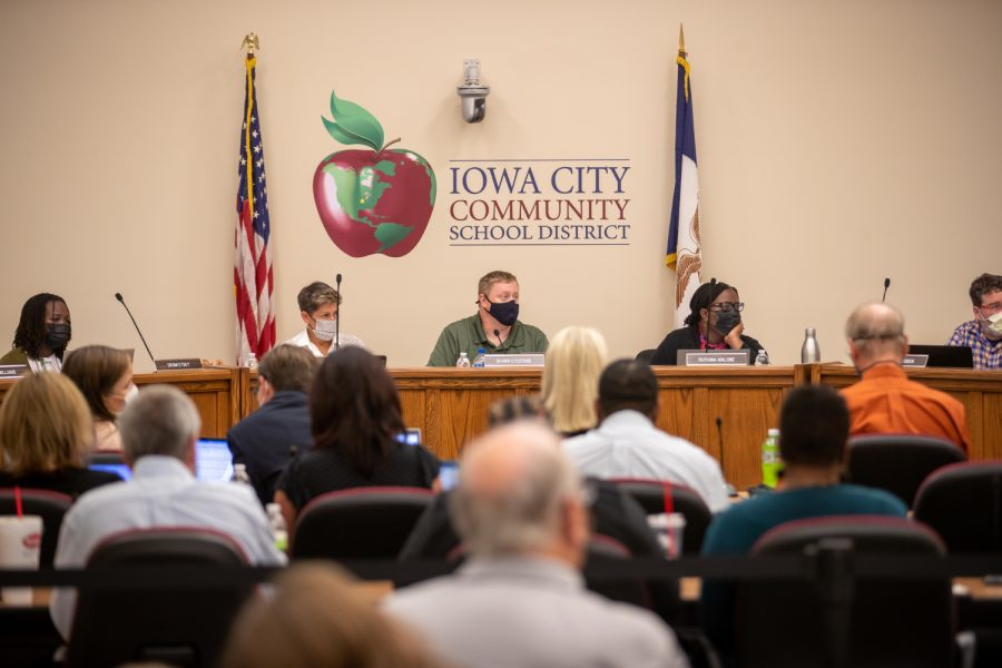 Members of the Iowa City Community School District Board listen to members of the crowd during an Iowa City Community School District meeting in Iowa City on Tuesday, Sept. 14, 2021.