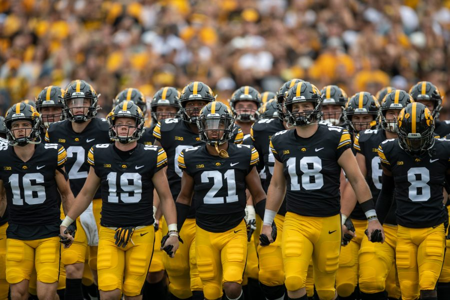 The Iowa football team enters the field before a football game between No. 18 Iowa and No. 17 Indiana at Kinnick Stadium on Saturday, Sept. 4, 2021. The Hawkeyes defeated the Hoosiers 34-6.