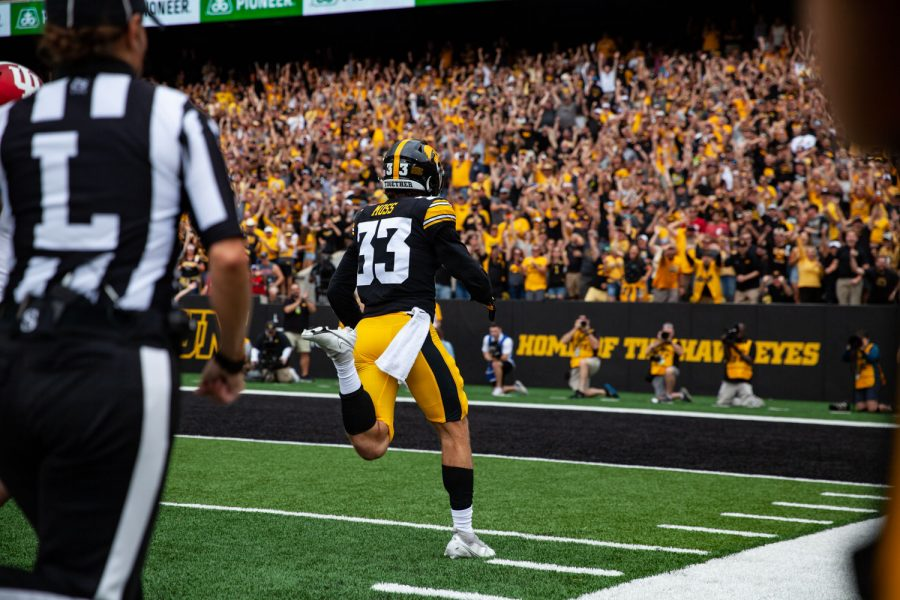 Iowa defensive back Riley Moss returns an interception for a touchdown during a football game between No. 18 Iowa and No. 17 Indiana at Kinnick Stadium on Saturday, Sept. 4, 2021. The Hawkeyes defeated the Hoosiers 34-6. Moss had two interception on the day.
