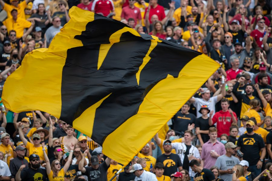 A W flag flies before the game during a football game between No. 18 Iowa and No. 17 Indiana at Kinnick Stadium on Saturday, Sept. 4, 2021. The Hawkeyes defeated the Hoosiers 34-6.