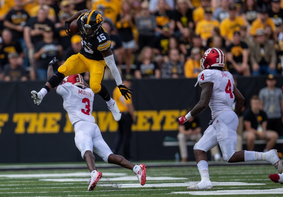 Iowa running back Tyler Goodson hurdles Indiana defensive back Tiawan Mullen during a football game between No. 18 Iowa and No. 17 Indiana at Kinnick Stadium on Saturday, Sept. 4, 2021. The Hawkeyes defeated the Hoosiers 34-6.