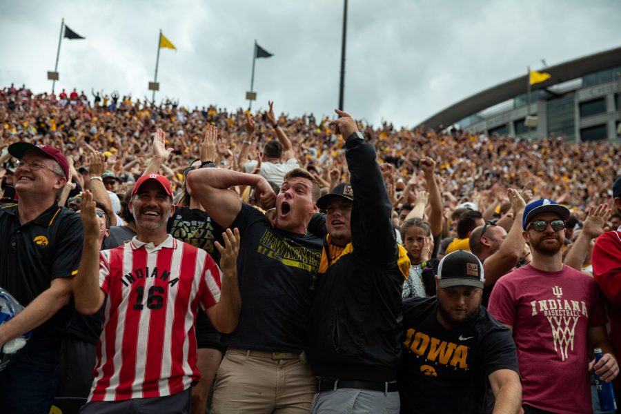 Fans celebrate during a football game between No. 18 Iowa and No. 17 Indiana at Kinnick Stadium on Saturday, Sept. 4, 2021. The Hawkeyes defeated the Hoosiers 34-6. It has been 651 days since fans were allowed into Kinnick.