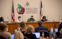 Members of the Iowa City Community School District Board listen to members of the crowd during an Iowa City Community School District meeting in Iowa City on Tuesday, Sept. 14, 2021. Members of the audience argued for and against a mask mandate within the school district.